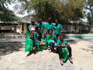 Volunteer with African children