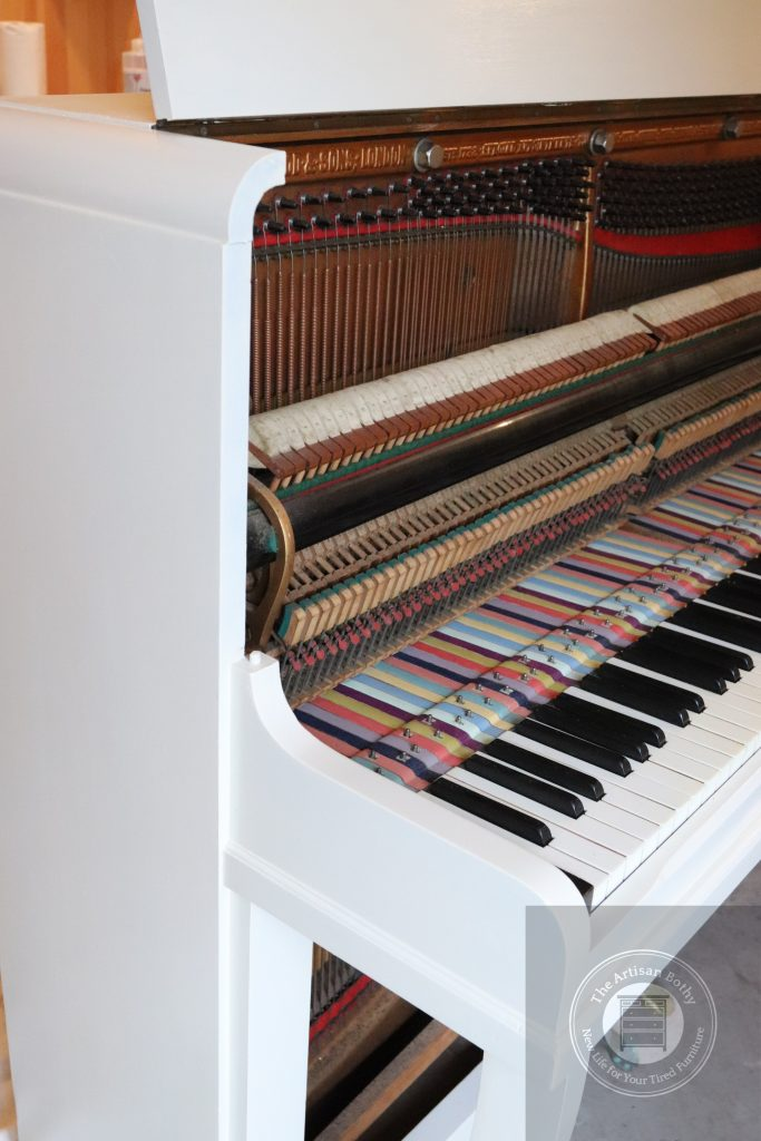 Chalk painting a piano