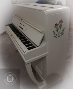 Painted piano with thistles