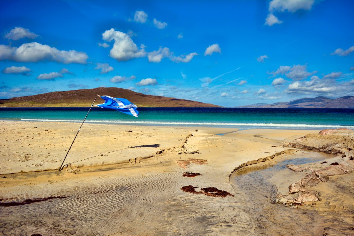 Scottish flag on a beach in a country divided